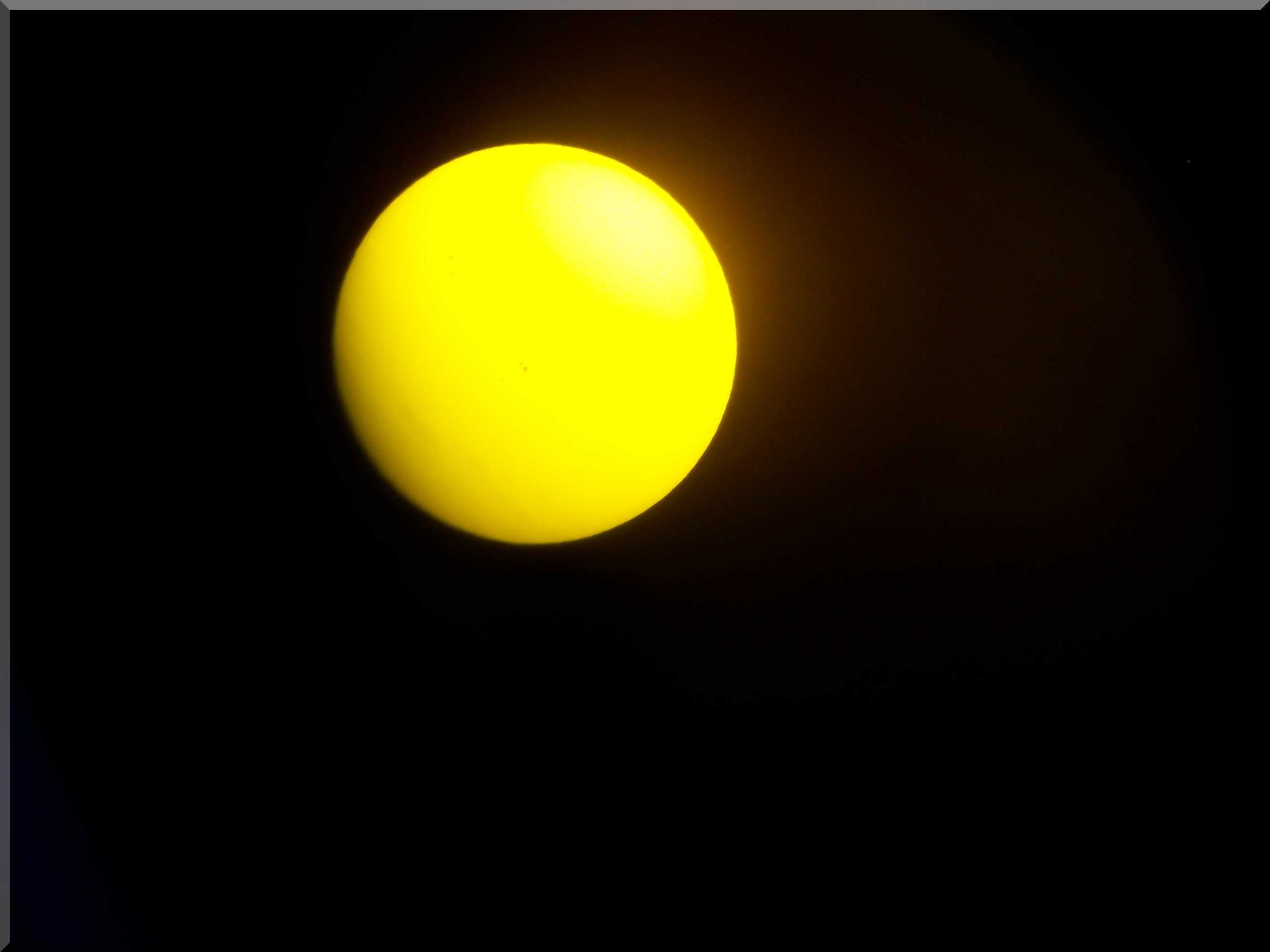 Sunspots, yellow filter